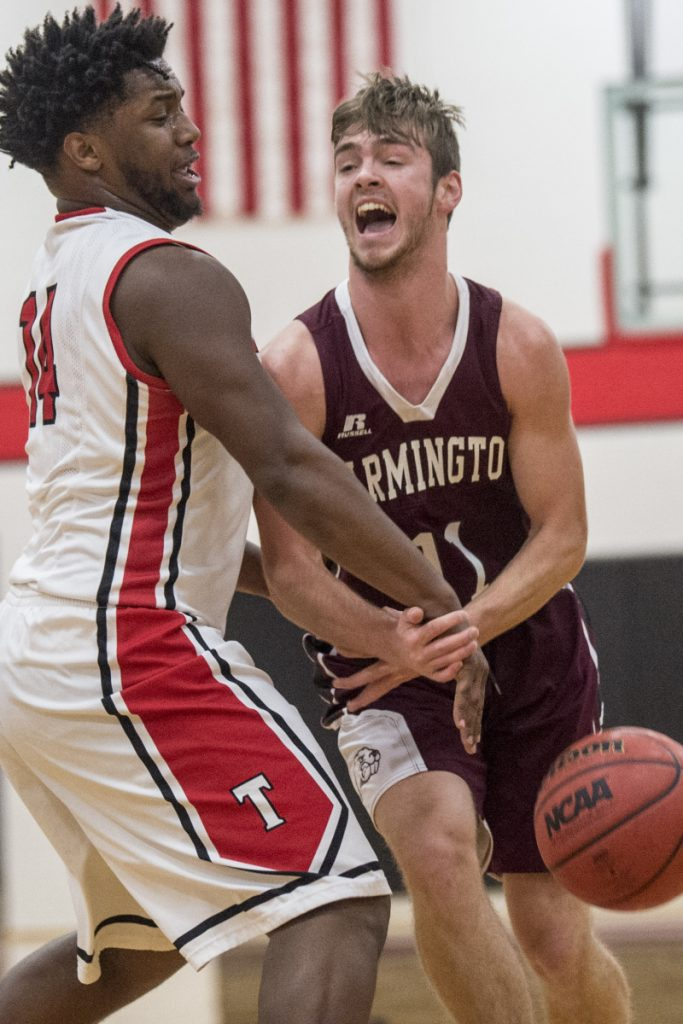 Thomas College's Justin Butler, left, strips the ball from University of Maine at Farmington's Isaac Witham (11) during a game last season at Thomas College in Waterville.