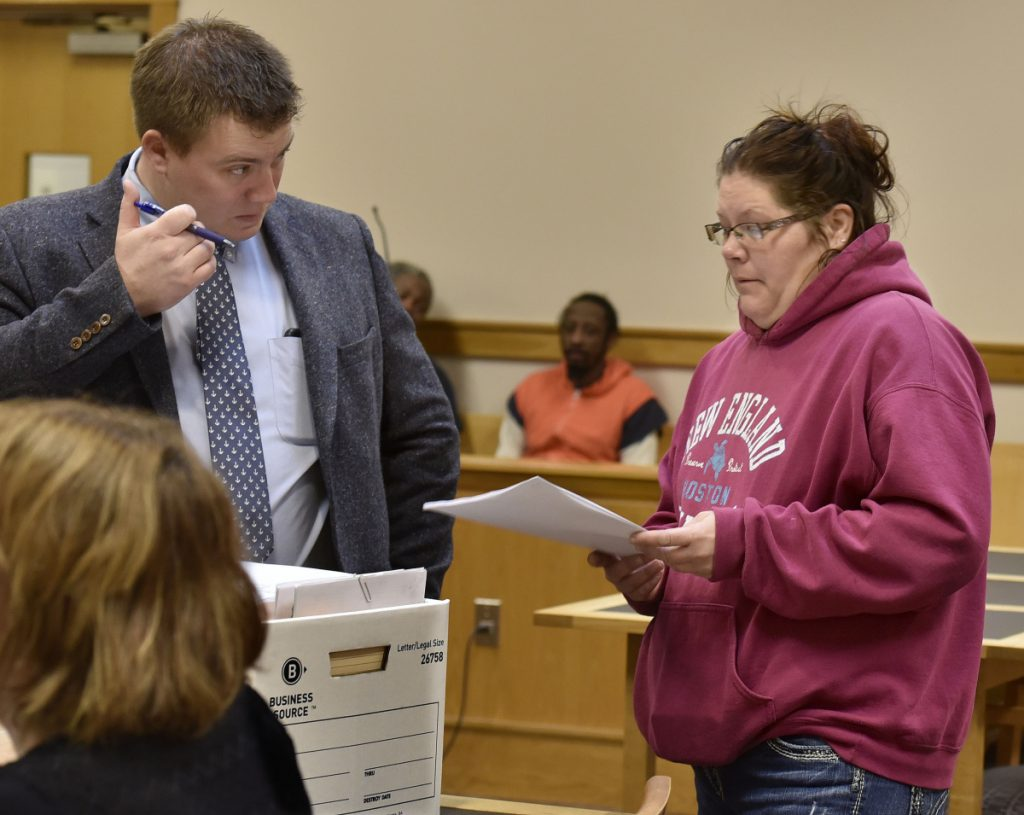 Assistant District Attorney Frank Griffin speaks with defendant Jaime Danforth before a hearing Wednesday in Somerset County District Court in Skowhegan. Danforth has been charged with animal trespass after her Holstein cow wandered on to a neighbor's property, where it was shot. The case may go to trial next spring.