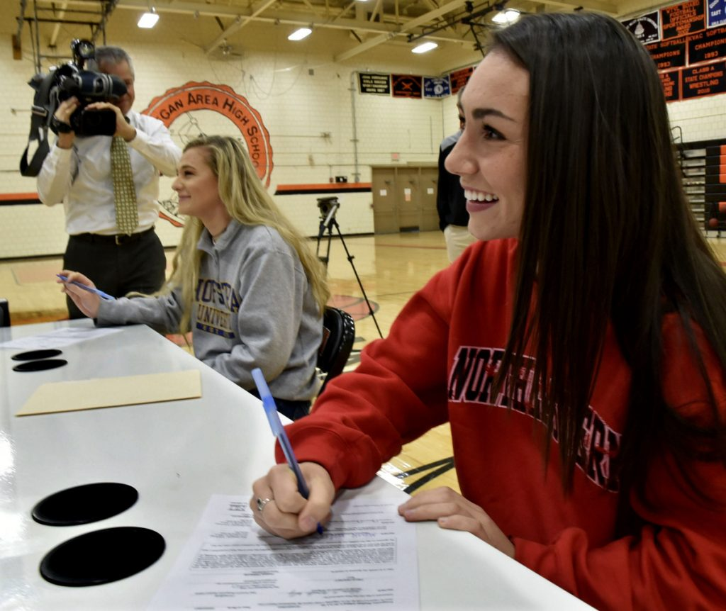 Skowhegan field hockey players Lizzie York, left, and Maliea Kelso were the center of attention while signing letters of intent for Division I colleges Wednesday in Skowhegan.