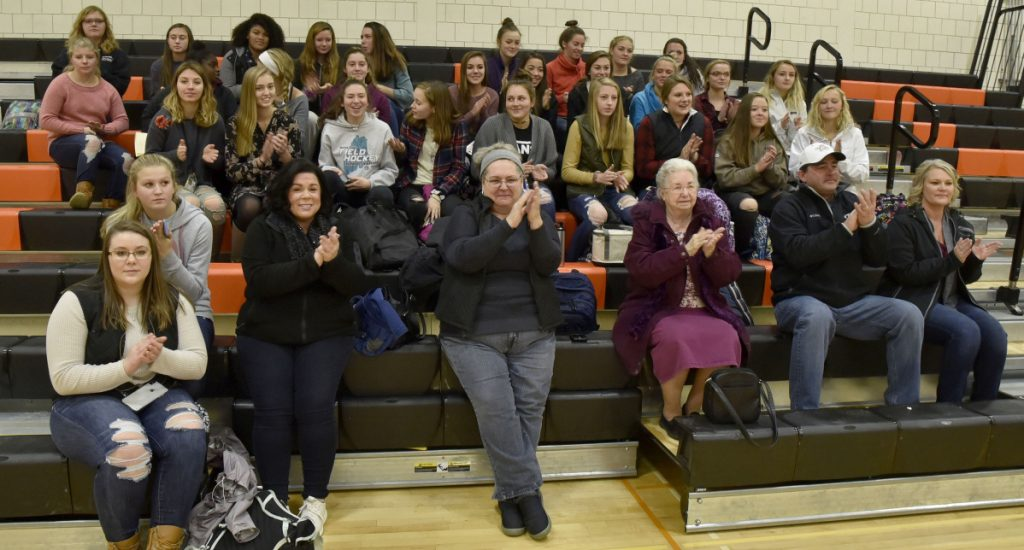 Family and team members of Skowhegan field hockey players Lizzie York and Maliea Kelso applaud after the students signed letters of intent to play for Division I colleges Wednesday in Skowhegan.