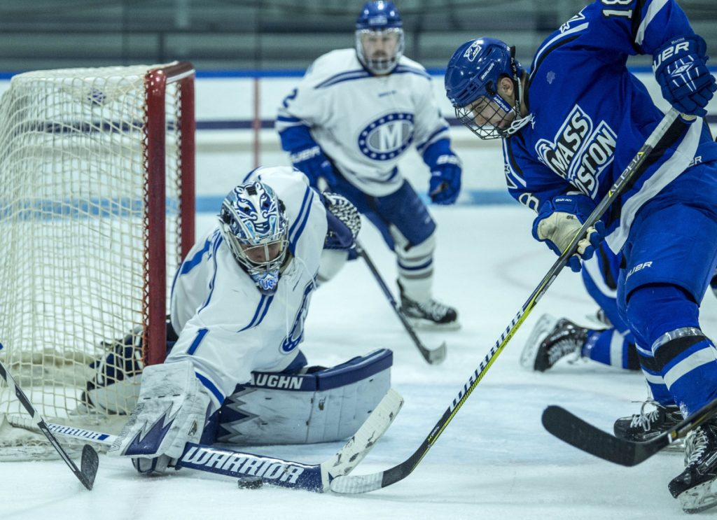 Colby College goalie Andrew Tucci (1) makes a save against UMass Boston's Zach Bross (18) during a game last season at Alfond Rink in Waterville.