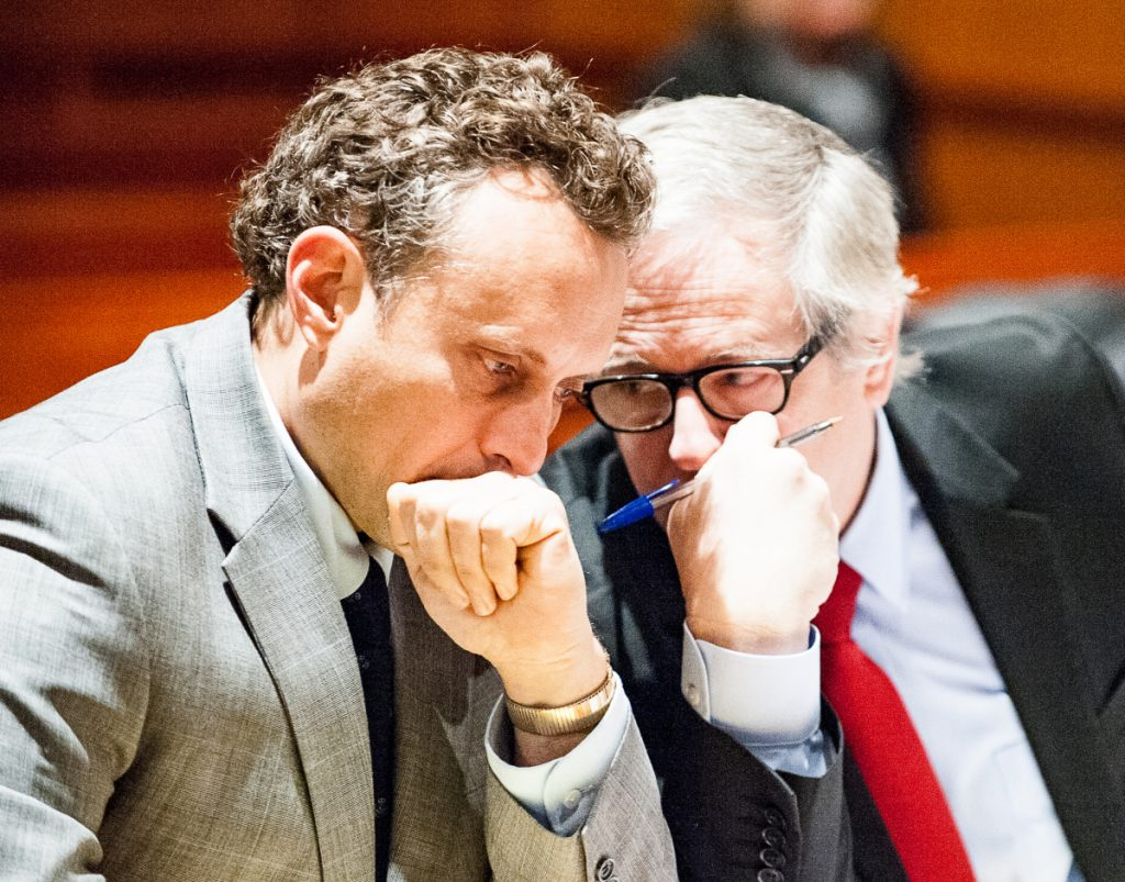 Lewiston attorney James Howaniec, right, speaks with his client, suspended lawyer Seth Carey, on Wednesday morning in Cumberland County Superior Court in Portland during Carey's sanctions hearing.