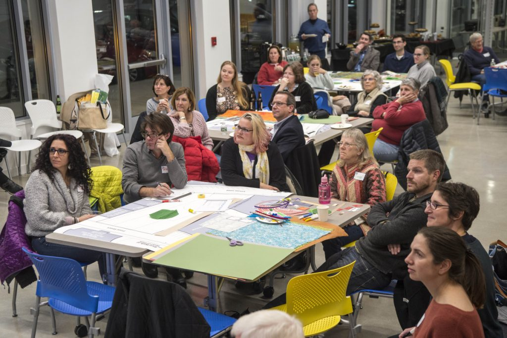 Members of the community gather on Wednesday at the Bill and Joan Alfond Commons as Neil Kittredge, an architect with Beyer, Binder and Belle, discusses design approaches for the new arts center and Castonguay Square during a community workshop.