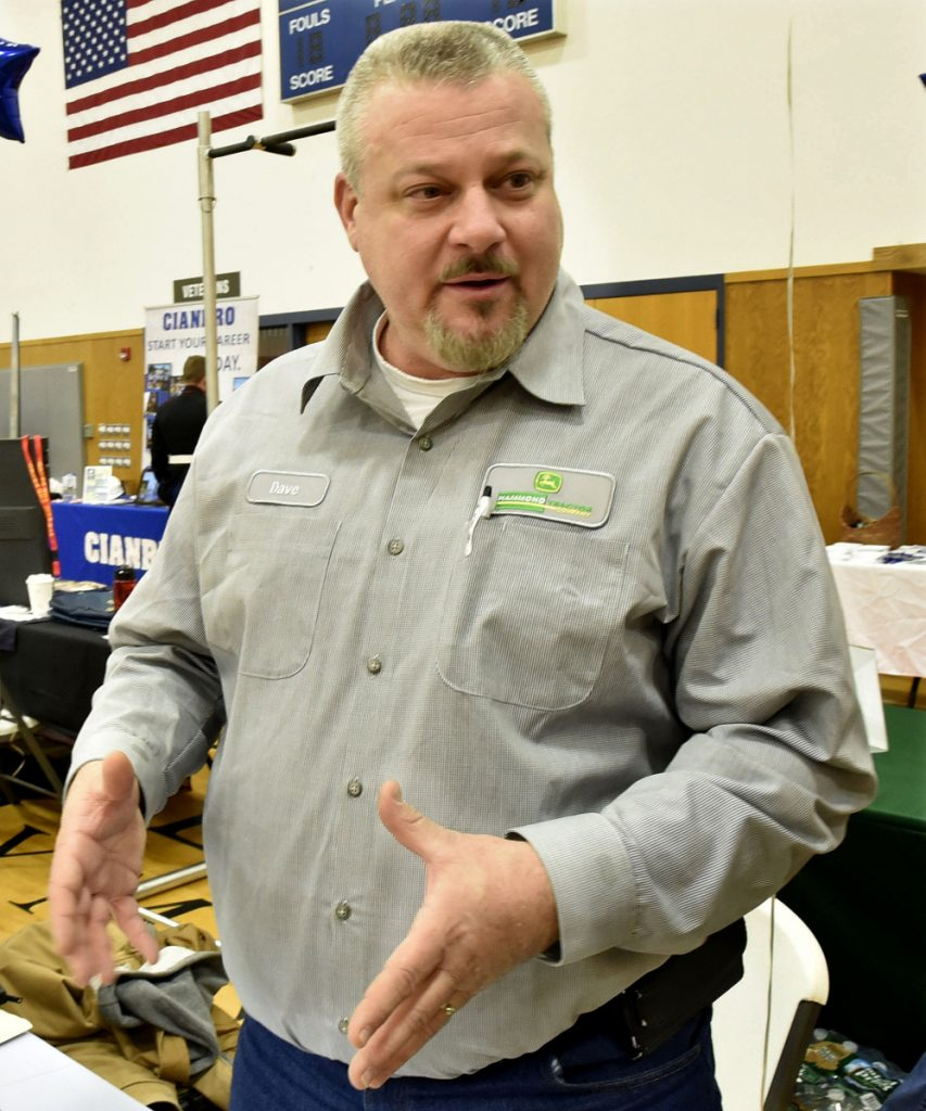 David Ponsant, of Hammond Tractor, was one of the job recruiters Thursday at a job fair held at Kennebec Valley Community College's Hinckley campus.