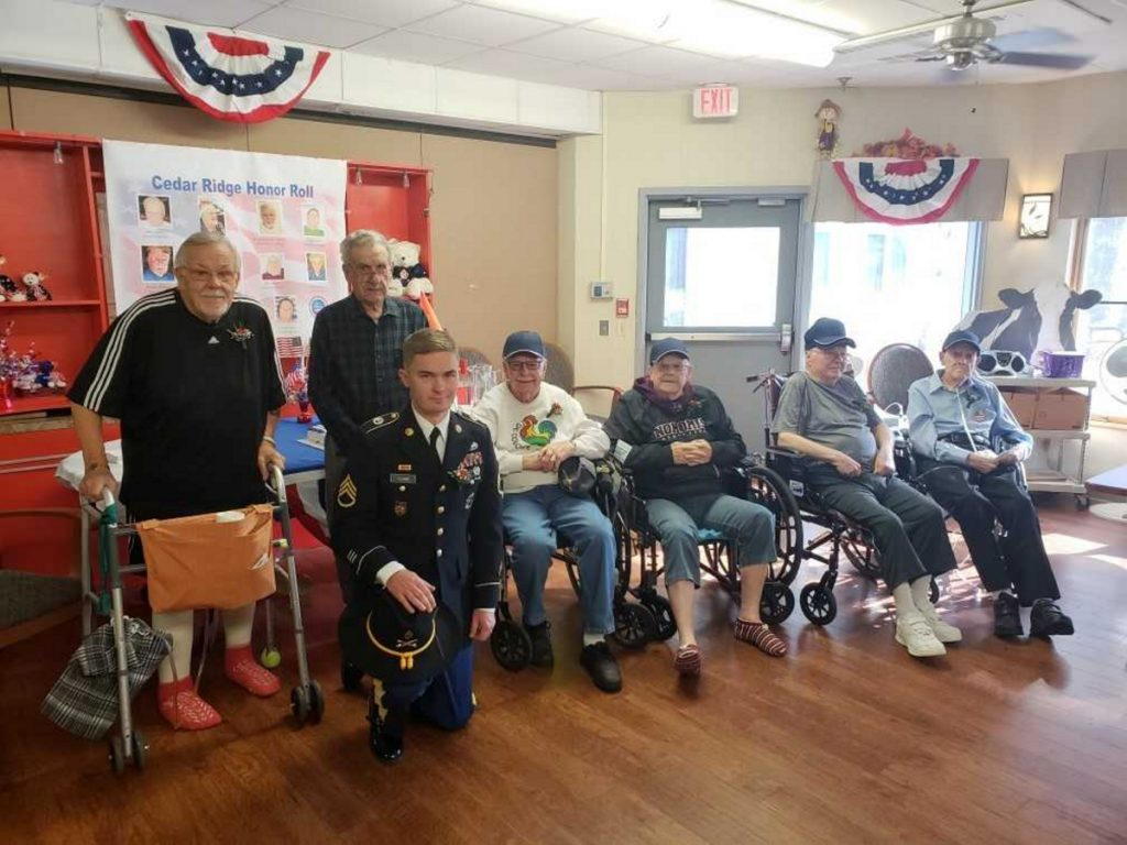 "Skowhegan's Cedar Ridge Center held a Veterans Recognition Ceremony on Monday. Nov. 12. Staff Sgt. Brian Leard is kneeling in front. Back from left are veterans Freeman ""Buzzy"" Buzzell, Philias Johnson, William Burkhart, Frank Dore, Basil ""Bud"" Andrews and Robert Chadbourne."