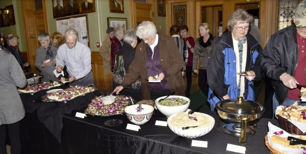 Plenty of Lebanese food was available for fans of local author Earl Smith during a reception Thursday in the Waterville City Hall lobby. Waterville's diversity and its immigrant population were topics of Smith's new book and his presentation Thursday.