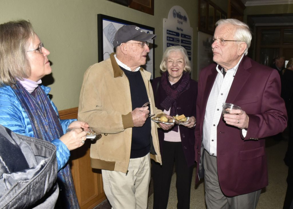 "Earl Smith, right, speaks with, from left, Cate Ashton and Karl and Jane Dornish, during a reception for Smith, who gave a presentation on his new book, ""Water Village, The Story of Waterville, Maine,"" on Thursday at the Opera House."