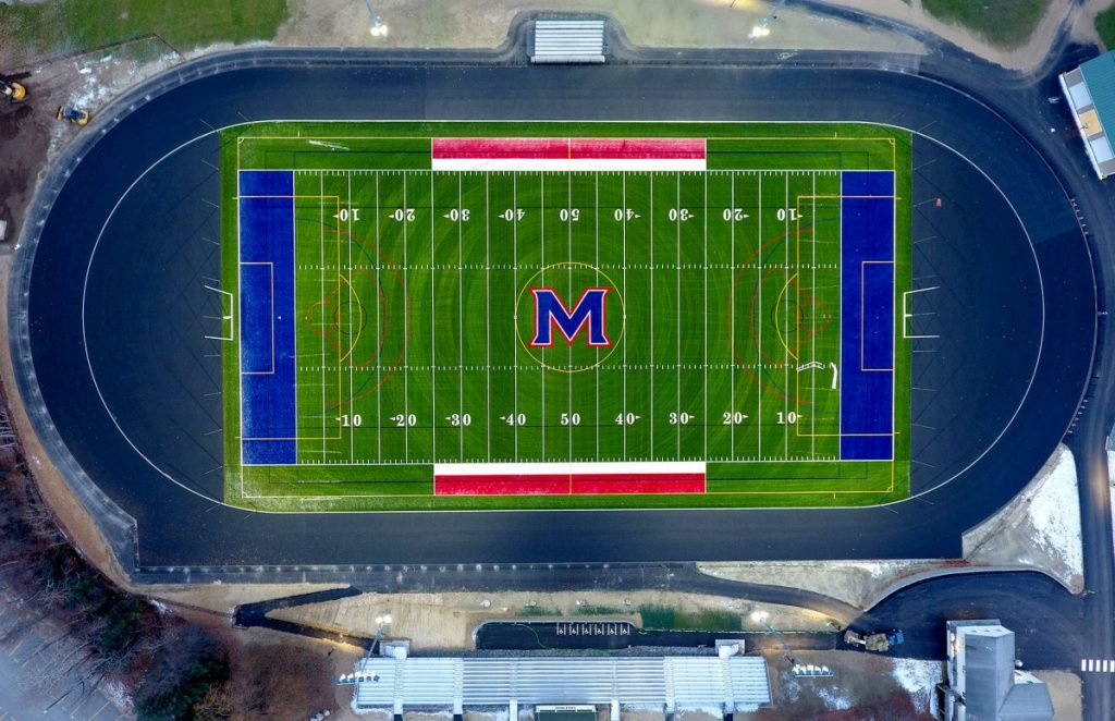 The new Messalonskee High School field for football, soccer and lacrosse, track and bleachers — seen Nov. 15 in an aerial view from a drone on Thursday — is lit up with new lights at the Oakland school.