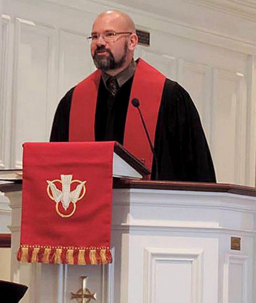The Rev. Mark Wilson conducts a service at the First Congregational Church in Waterville.