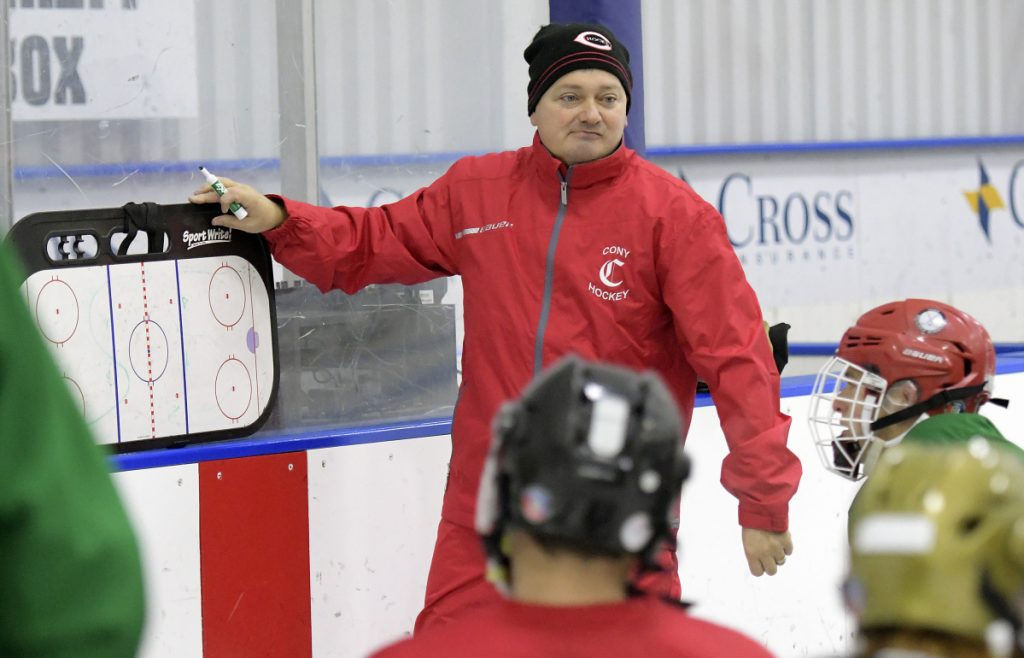 New Cony hockey coach Shawn Johnson goes over a drill during the first day of pracrice Monday in Hallowell.