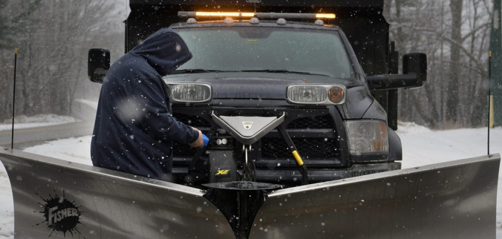 B.J. Robbins replaces fluid in a plow Tuesday at the Litchfield town garage as a snowstorm moves through the region. Plow operators were preparing equipment across Maine because several inches of fresh snow was predicted.