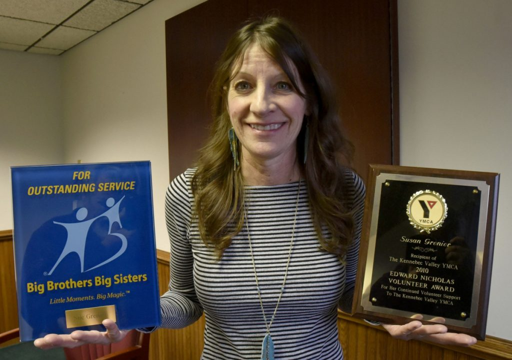 Sue Grenier is well know for her volunteer work and community involvement as illustrated with two plaques for volunteerism from Big Brothers Big Sisters and Kennebec Valley YMCA organizations. (Staff Photo by David Leaming/Staff Photographer)
