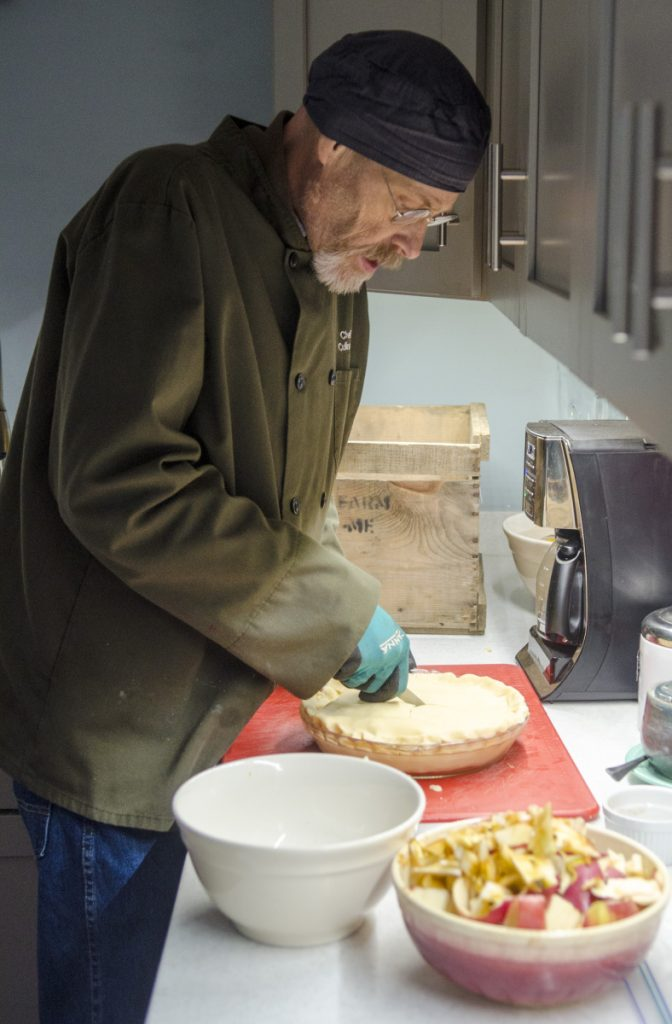 Eric Thoreson makes an apple pie Tuesday at his Winthrop home for the Rotary Club of the Winthrop Area's Thanksgiving dinner.