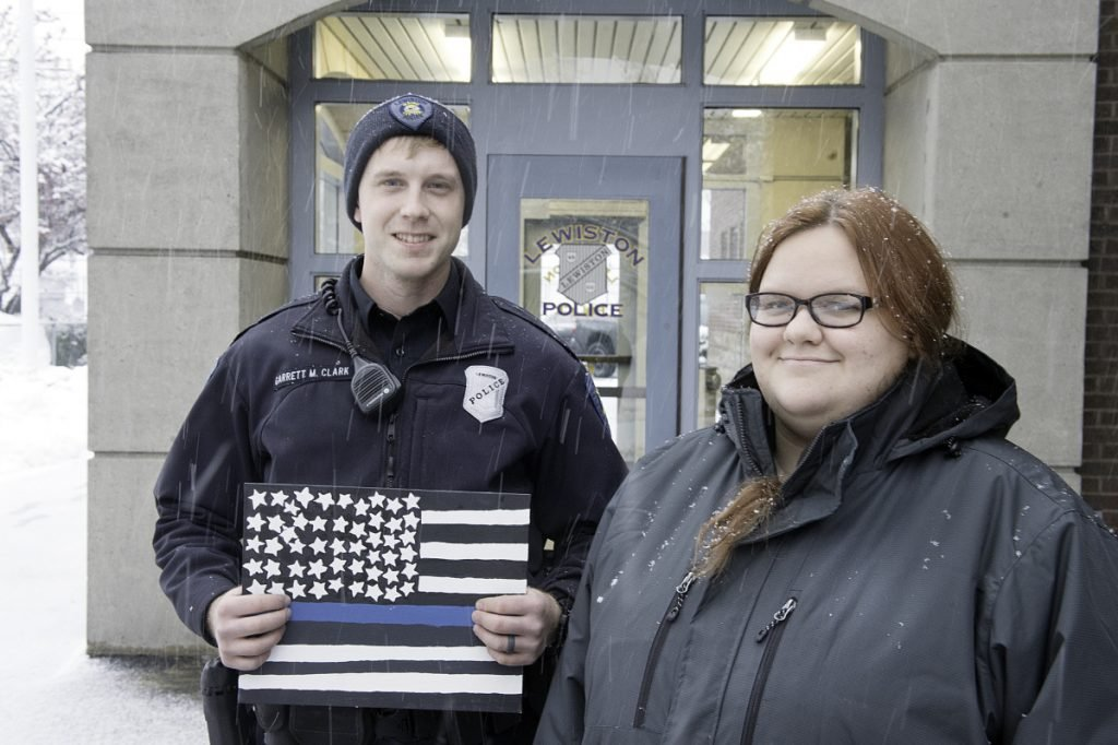 Keirsten Walder is thankful that Lewiston police Officer Garrett Clark stayed with her and encouraged her when she felt suicidal in 2017. As thanks, Walder made a Thin Blue Line American flag for Clark.