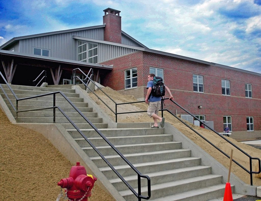 A student scales the steps to the new Maranacook Middle School in 2001 in Readfield.