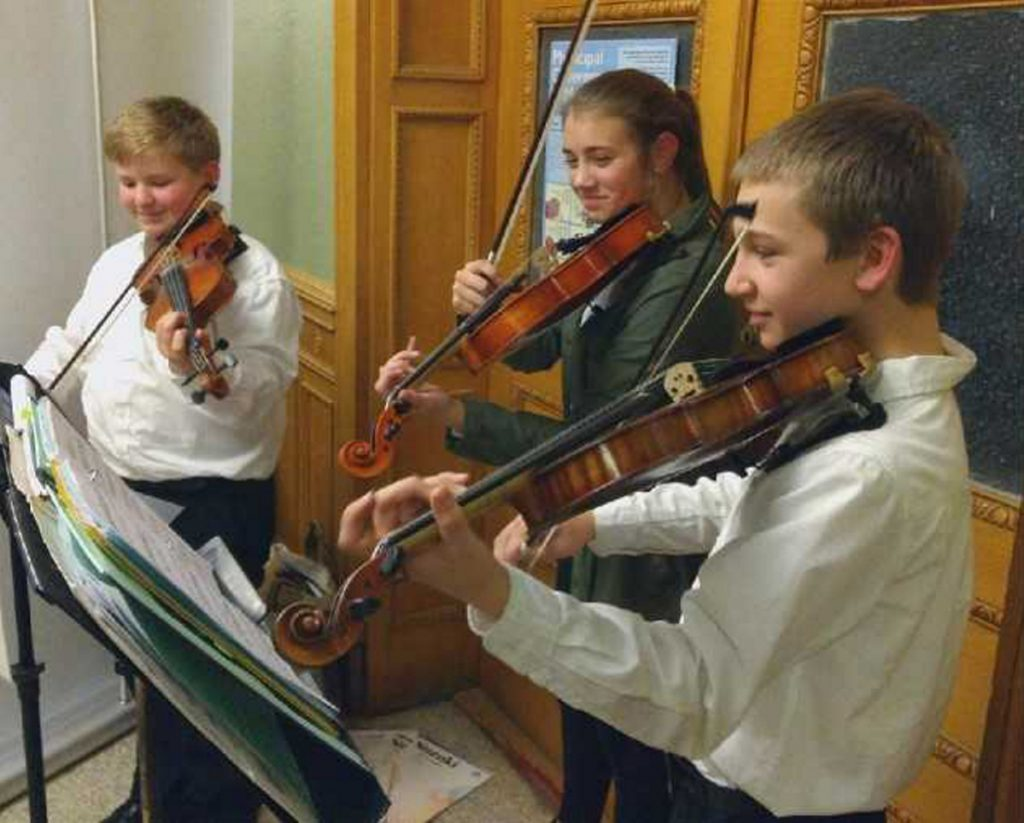 "Kennebec Valley Youth Symphony Orchestra's strings students Owen Kennedy, Sophia Scheck and Aiden Montmeny recently entertained at the Bangor Savings Bank Hello Dolly reception. The students are preparing for their upcoming Dec. 9 concert at Hall-Dale High School in Farmingdale. For more information, visit <a href=""http://www.kvyso.org"">www.kvyso.org</a>."