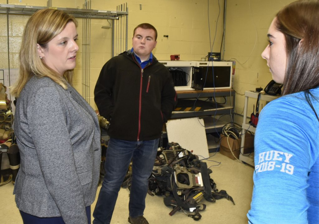 "Beth Carlton, left, student services coordinator at Mid-Maine Technical Center in Waterville, on Nov. 15, speaks with students Bryce Scott and Michaela Huey about the ""Say Something"" app for cellphones. Students will be offered the app to be used to notify officials if they hear or read inappropriate threats or comments."