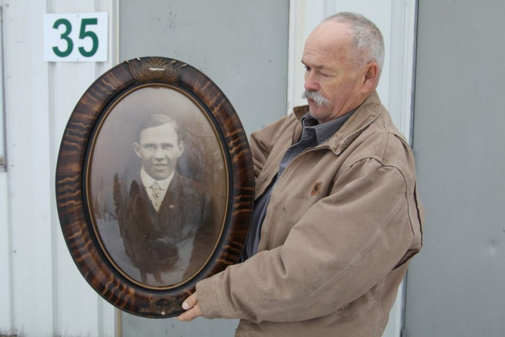 Windsor Historical Society President Robert Brann holds a portrait of Windsor's lone World War I fatality, Harold Sproul, on Nov. 19 outside the Windsor Museum.
