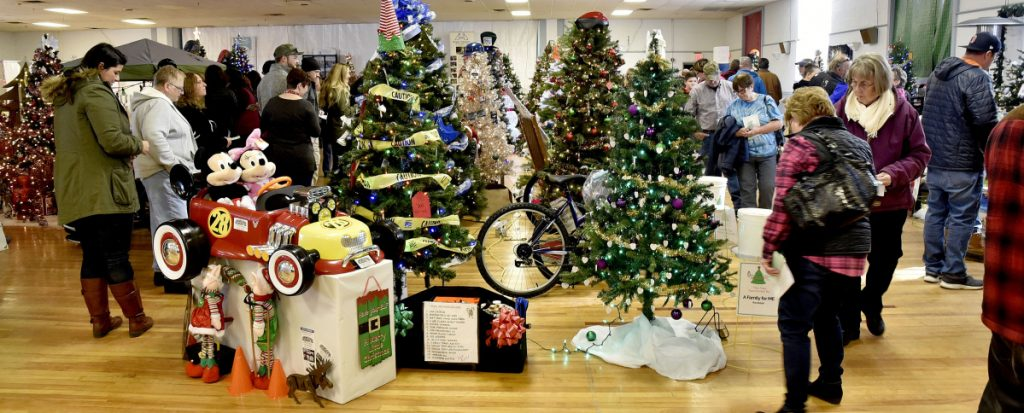 People in the holiday spirit filled the former American Legion hall in Waterville the last two weekends to decide which trees and gifts to take a chance on during the fourth annual Sukeforth Family Festival of Trees event held at the former American Legion Hall in Waterville. Decorated trees and gifts from 72 vendors were offered, and the proceeds go to Hospice Volunteers of Waterville Area, Spectrum Generations Meals on Wheels and Maine Children's Home for Little Wanderers.