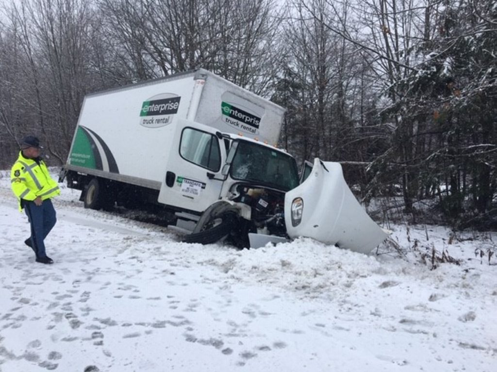 An Enterprise box truck is off the road on Route 3 following a fatal motor vehicle accident in front of Lake St. George State Park Tuesday morning.