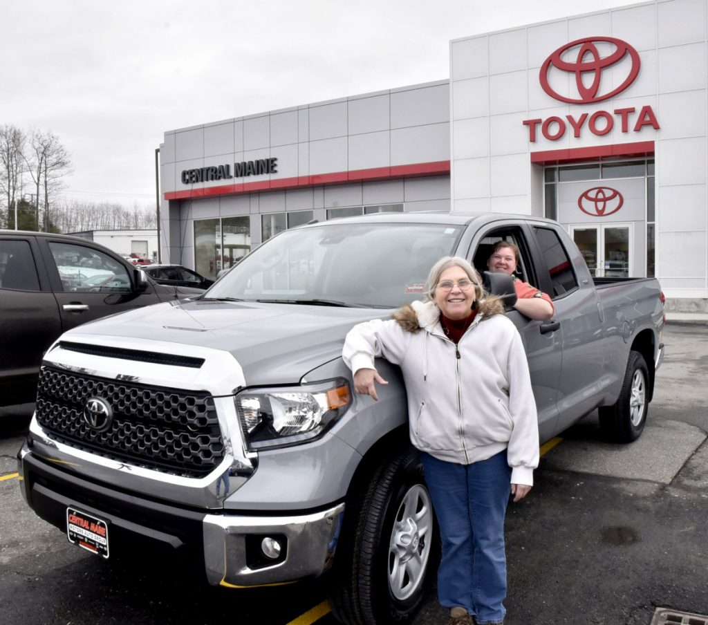 Sue Quimby, left, of Palmyra, stands on Thursday beside her new Toyota Tundra pickup truck at Central Maine Auto Group Toyota dealership in Waterville. Quimby won the truck in the national Bassmaster Toyota Ultimate Tundra Giveaway contest. Her daughter Alice Humphrey is behind the wheel.