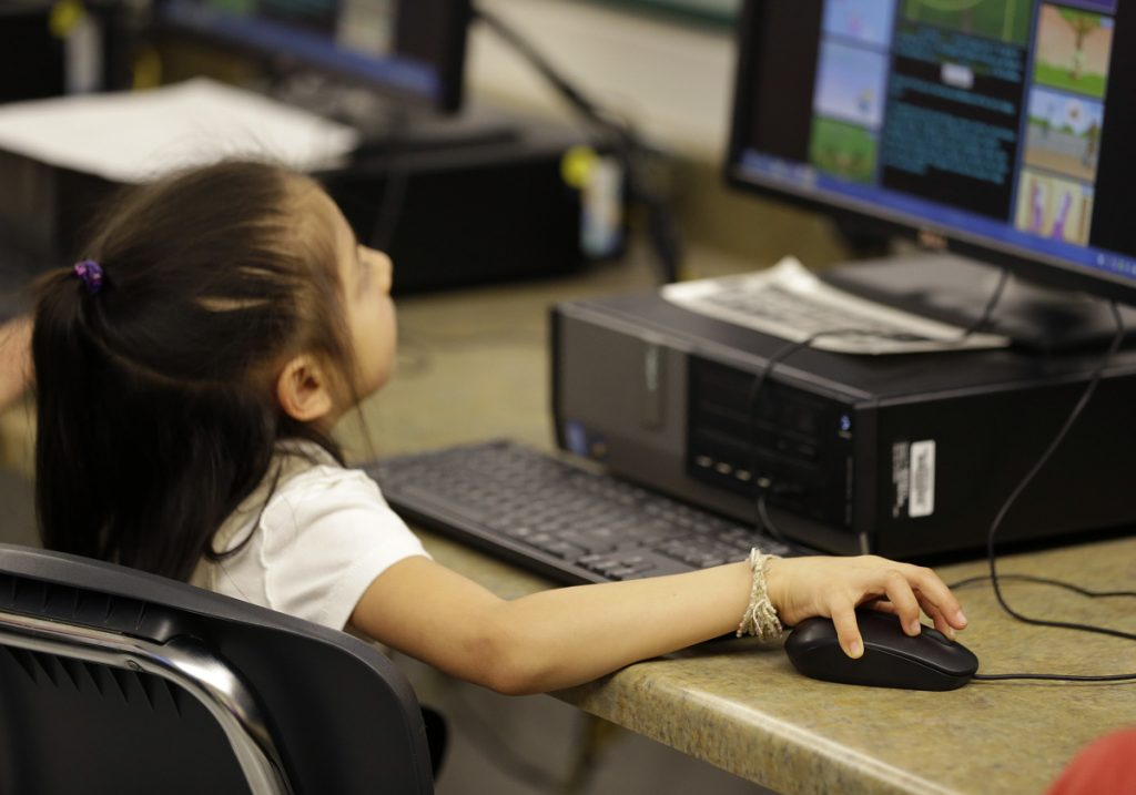 A first-grader practices keyboarding skills at Bayview Elementary School in San Pablo, Calif. in 2015. Amazon and other tech companies are pushing the nation's schools to teach coding.