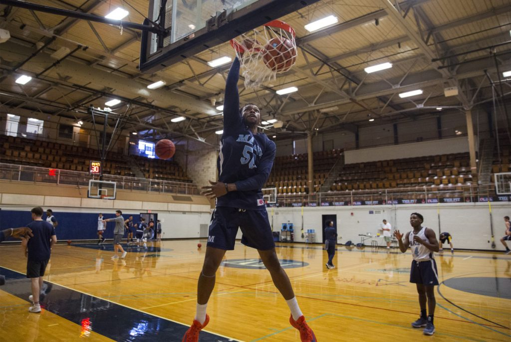Vincent Eze dunks during UMaine's first practice, Sept. 26 in Orono. The Black Bears open their season Tuesday under new head coach Richard Barron, the former Maine women's coach.