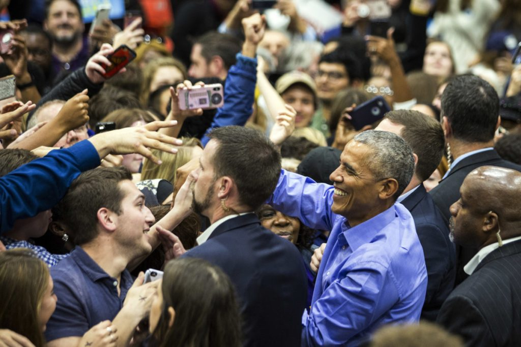 Former President Obama greets people at a rally for Illinois Democrats on Sunday in Chicago.