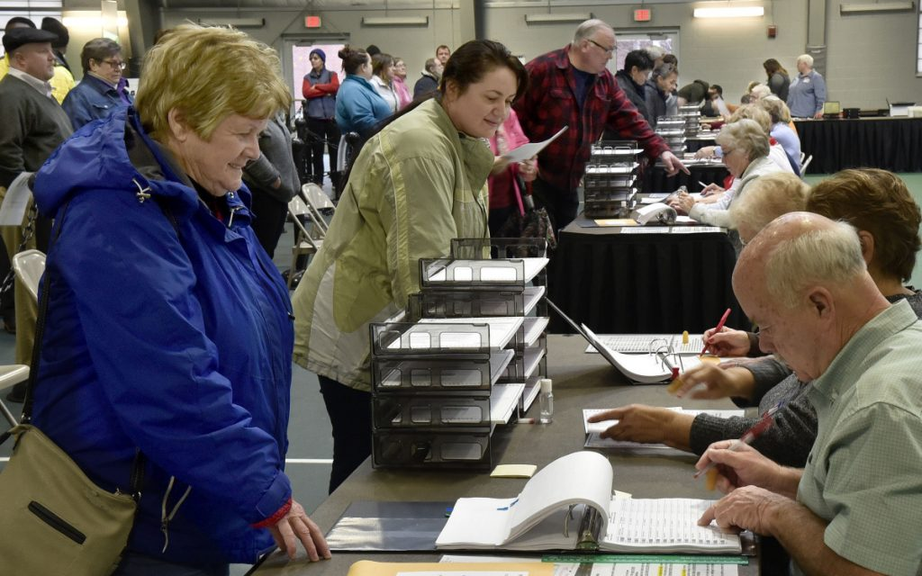 Waterville voters check in with election clerks before voting at Thomas College on Tuesday.
