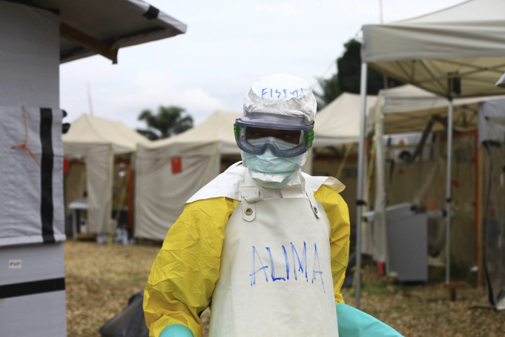 A health worker in protective gear arrives in September at an Ebola treatment centre in Beni, Eastern Congo.