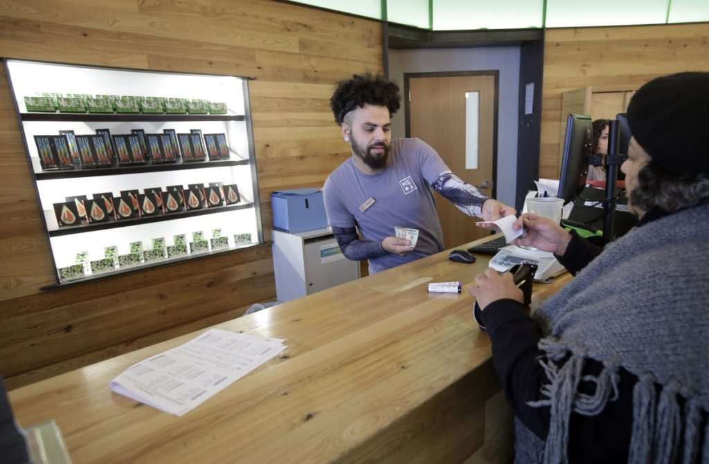 Nelson Rivera III sells medical cannabis products to Victoria Silva  at a New England Treatment Access medical marijuana dispensary, in Northampton, Mass. Within days perhaps, the medical marijuana dispensary in Northampton expects to receive the final go-ahead to sell recreational marijuana.