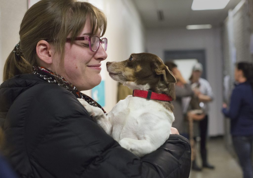 Betsy Caron of Portland holds Pocahontas, the seized dog she adopted Saturday at Midcoast Humane Society.