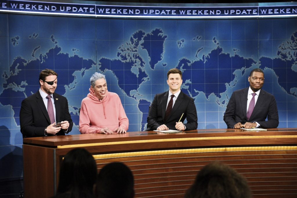 "Lt. Cmdr. Dan Crenshaw, from left, Pete Davidson, Colin Jost, and Michael Che appear during Saturday Night Live's ""Weekend Update"" in New York."