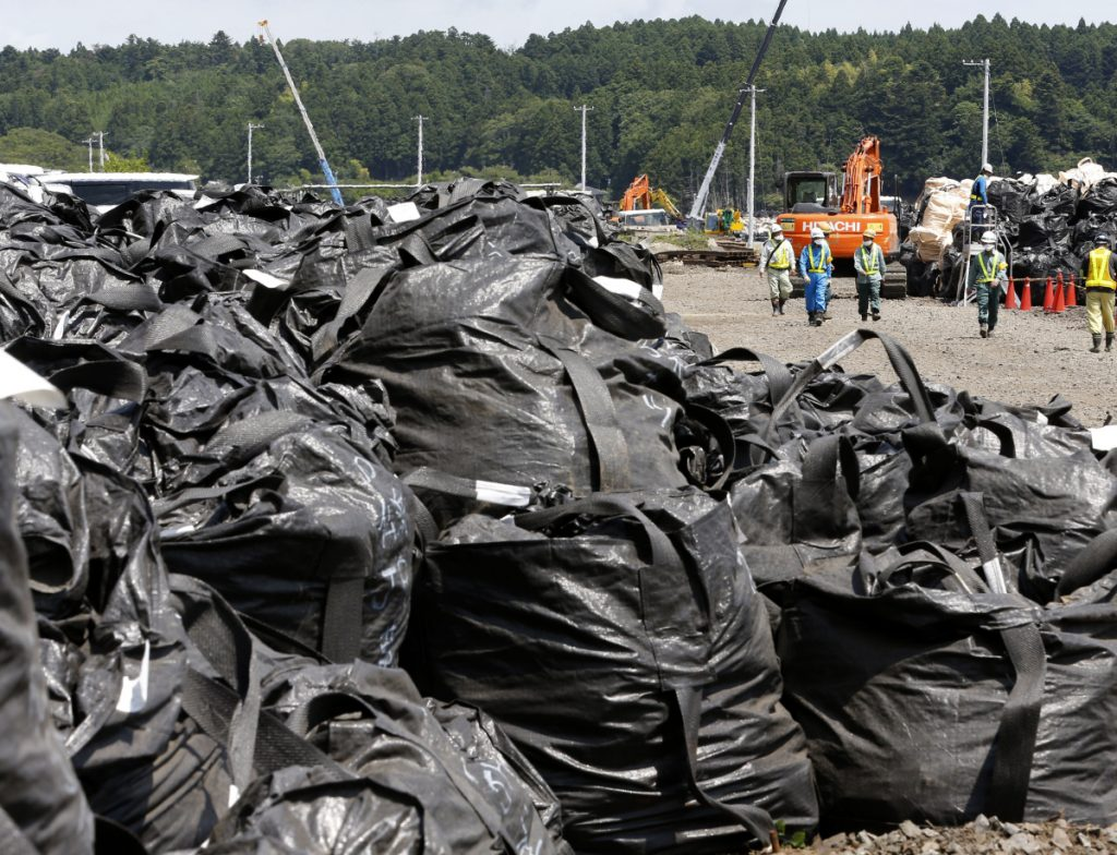 Bags of radioactive waste remain unprocessed at the Fukushima nuclear plant in 2016. Managing nearly 1 million tons of radioactive water is critical to the plant's safe and sustainable decommissioning, a team of experts says.