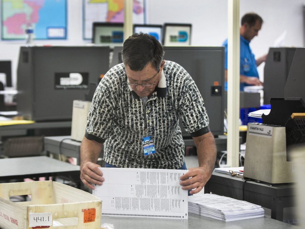 Miami-Dade Election Center supervisors recount the ballots and were already halfway through the recount total on Monday.