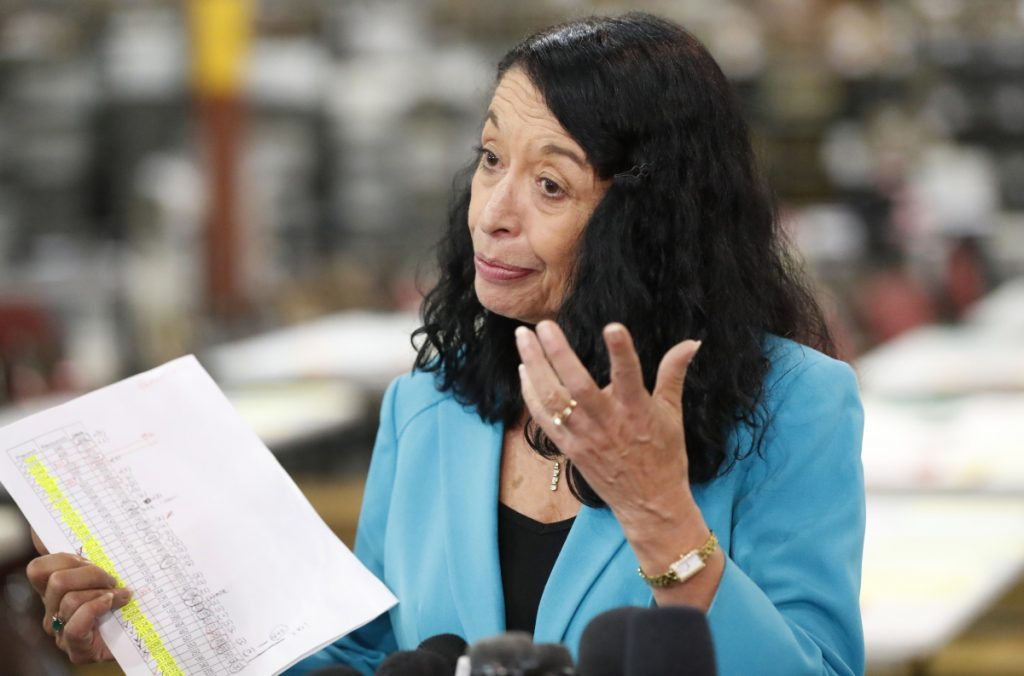 Palm Beach County Supervisor of Elections Susan Bucher holds up a tally sheet while speaking to members of the media at the Supervisor of Elections office after the deadline for a recount was reached Thursday in West Palm Beach, Florida.