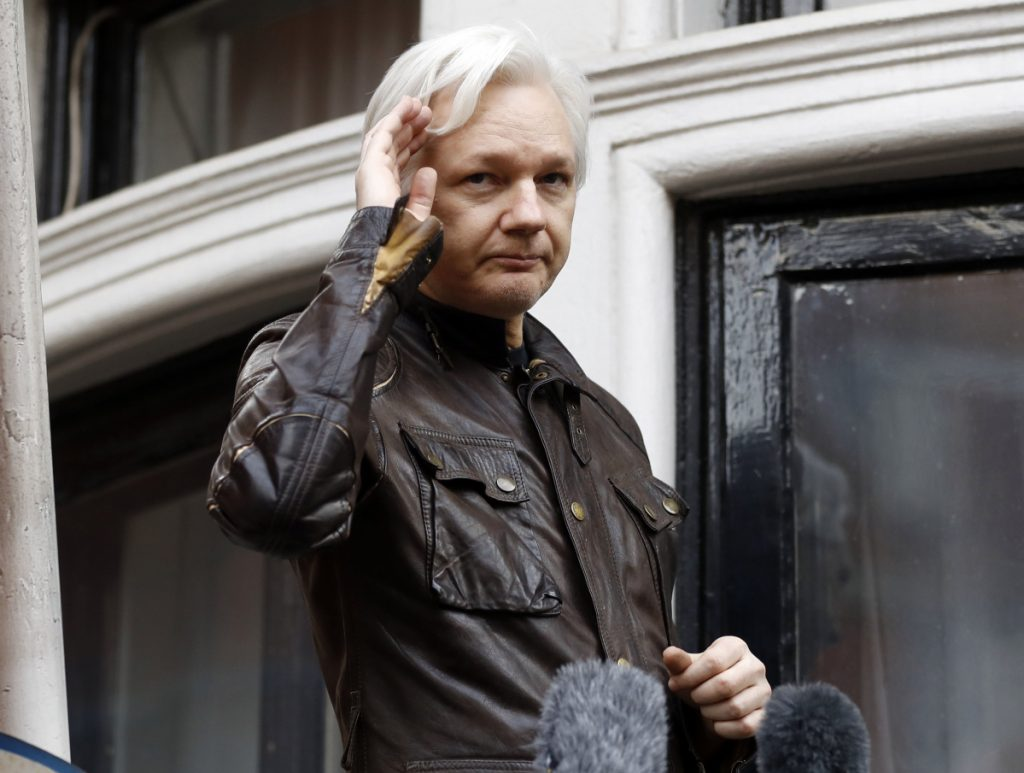 WikiLeaks founder Julian Assange greets supporters from a balcony of the Ecuadorian embassy in London. in 2017.