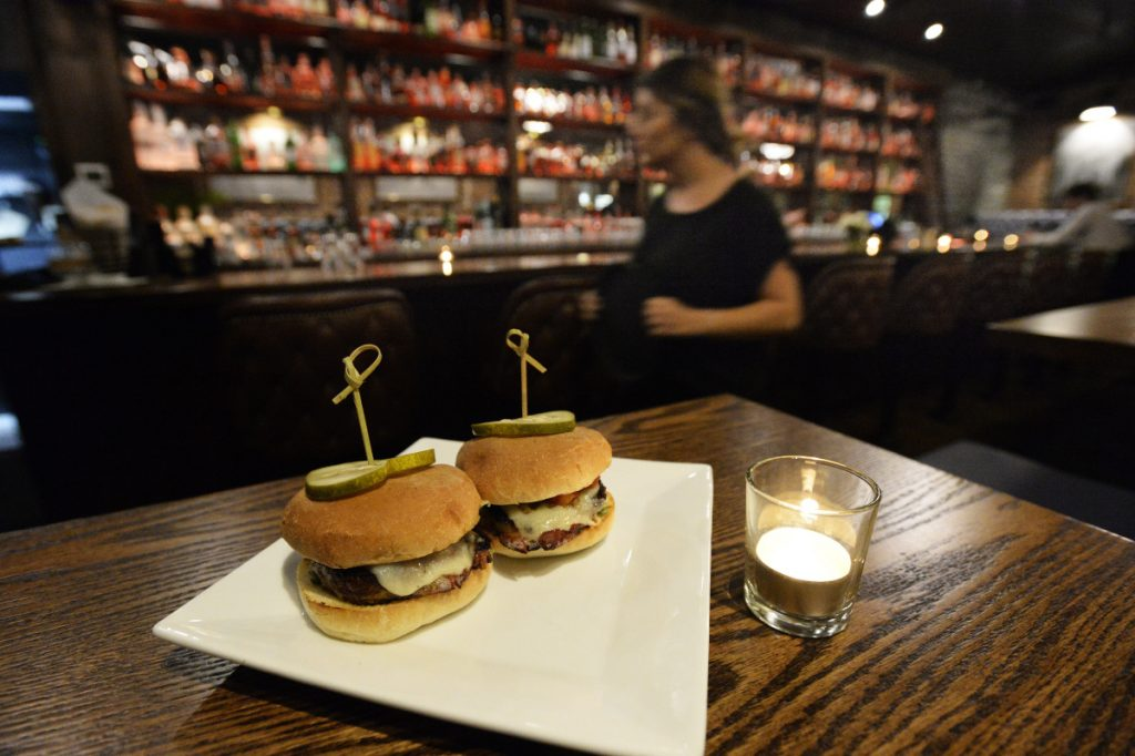 The meatloaf sliders are bacon-wrapped, tomato-jam-slathered discs of excellent housemade loaf topped with caramelized onions and the kitchen's own bourbon-infused ketchup.