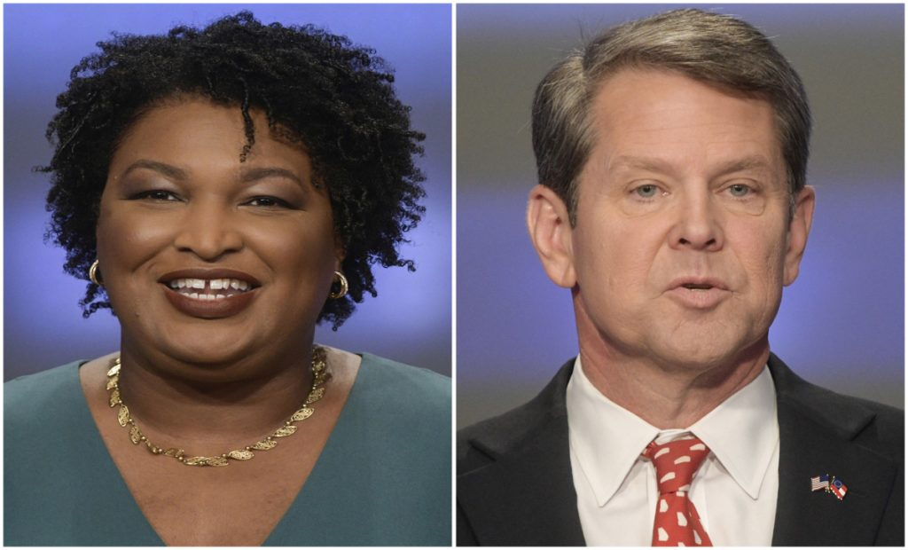 Georgia gubernatorial candidates Stacey Abrams and Brian Kemp. Abrams said Friday that there is no way she can win the race, which was undergoing a court-ordered review of absentee, provisional and other uncounted ballots.