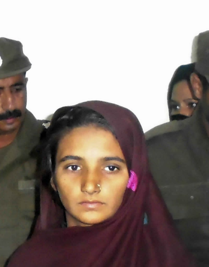 Aasia Bibi is presented to journalists at a police station in Muzaffargarh, Pakistan, in 2017.