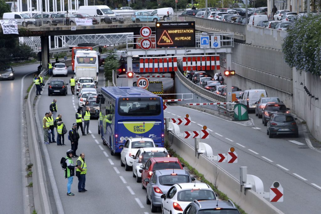 Demonstrators block a motorway exit to protest fuel taxes in Marseille, southern France, on Saturday. French interior ministry officials say that one protester was killed and more than 40 injured as demonstrators blocked roads around France to protest gas price increases.
