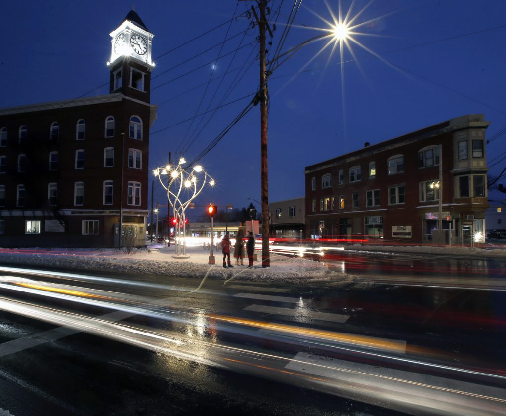 "The new public art at Woodfords Corner – ""Luminous Arbor"" by Aaron Stephan – stands at the corner of Woodford Street and Forest Avenue."