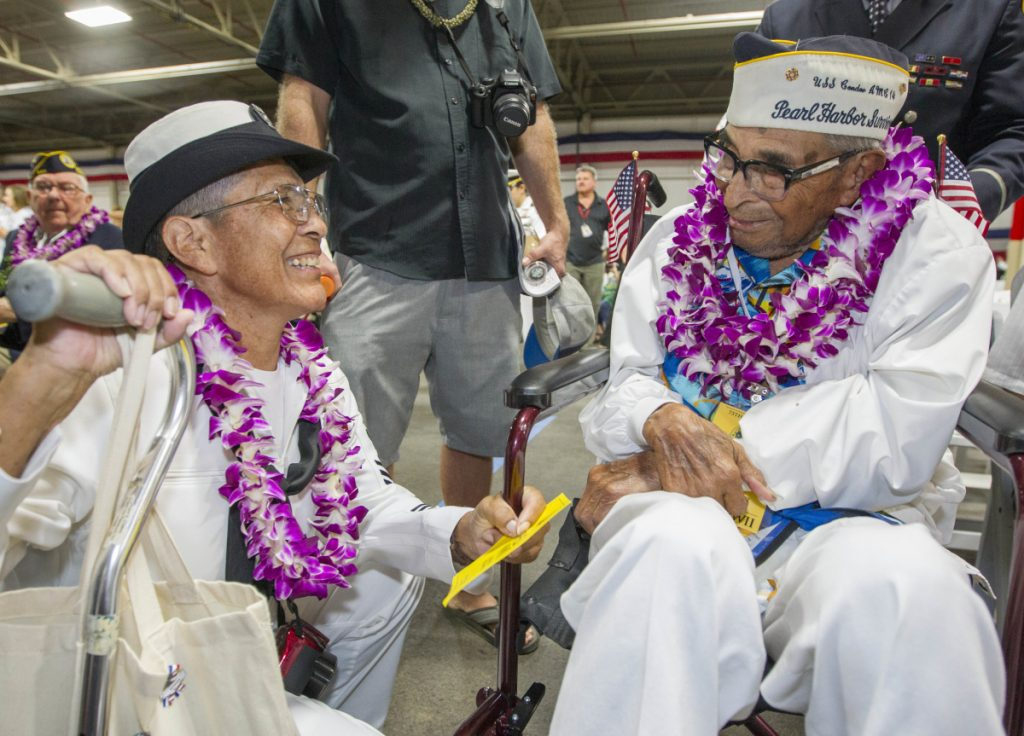Kathleen Chavez talks with her father, Ray Chavez, on Dec. 7, 2016, at Pearl Harbor remembrance ceremonies in Honolulu.