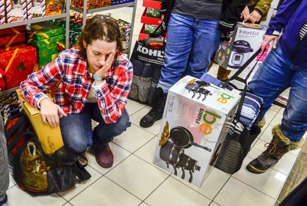 efdb16377f7 Megan McKenney of Lewiston waits in line to check out at 1 11 a.m. on Friday  at Kohl s in Augusta. She and her shopping group were planning to get  coffee ...