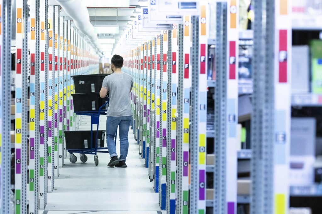An employee works Friday at an Amazon fulfillment center in Koblenz, Germany, on a day when hundreds of his colleagues across the continent went on strike.