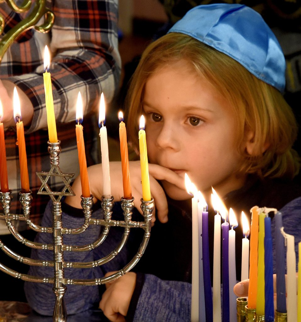 Candles on a Menorah lighted last Dec. 17 at Beth Israel Synagogue in Waterville represent hope emerging in darkness – a theme emphasized in filmmaker David Anton's 'Hanukkah: A Festival of deLights.'