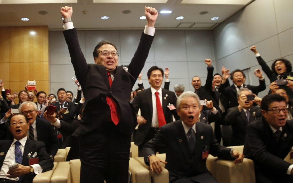 The Japanese delegation celebrates after winning the vote at the 164th General Assembly of the Bureau International des Expositions in Paris on Friday. Osaka beat out cities in Russia and Azerbaijan.
