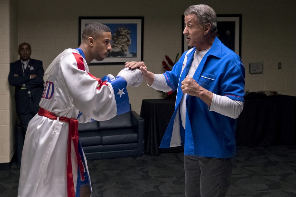 """Michael B. Jordan, left, and Sylvester Stallone in a scene from """"Creed II."""" The Rocky spinoff placed second with $35.3 million from the weekend and $55.8 million since Wednesday."""