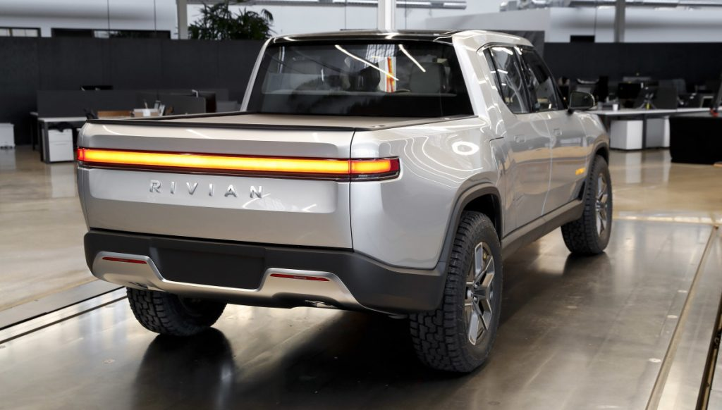 Rivian says the top version of its R1T pickup, above, will have more than 400 miles of battery range per charge. The five-seat, off-road-capable truck is aimed at a market that Tesla is not yet in.