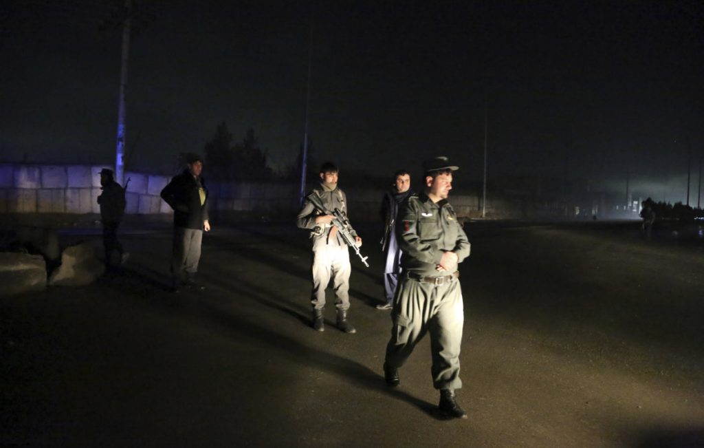 Security forces block the roads at the site of a suicide bomb attack in Kabul, Afghanistan, on Wednesday